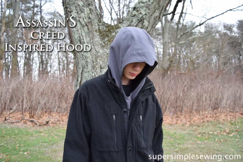 assassin's creed hood with type copy